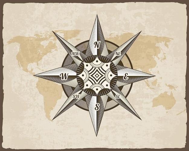 引き裂かれたボーダーフレームで古い紙のテクスチャの世界地図に航海のアンティークコンパスサイン。海洋のテーマと紋章の要素。ヴィンテージ風配図のエンブレム。 Premiumベクター