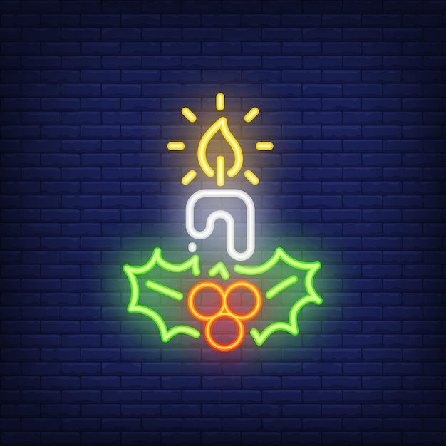 Neon candle and mistletoes. festive element. christmas concept Free Vector