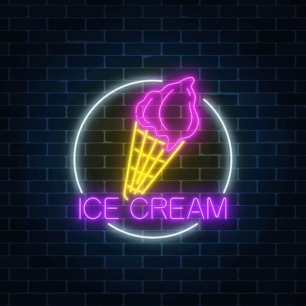 Neon glowing sign of cake with glaze in circle frame on a dark brick wall Premium Vector