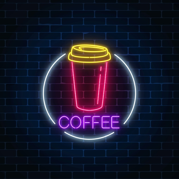 Neon glowing sign of coffee cup in circle frame on a dark brick wall Premium Vector