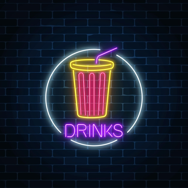 Neon glowing sign of cold soda drink in circle frame on a dark brick wall Premium Vector