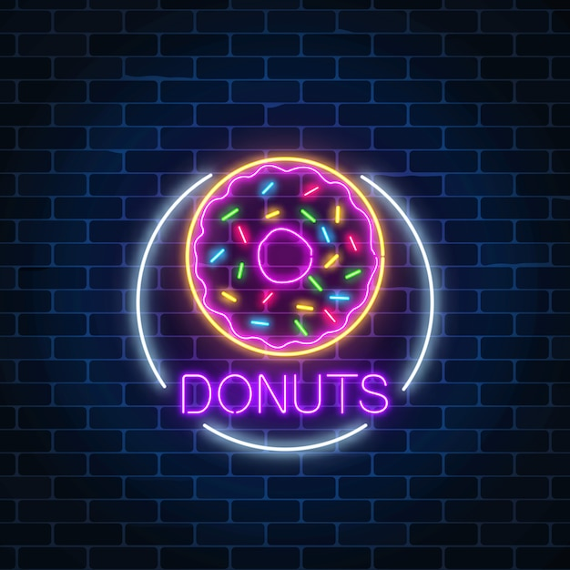 Neon glowing sign of donuts in circle frame on a dark brick wall Premium Vector