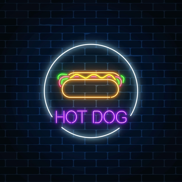 Neon glowing sign of hot dog in circle frame on a dark brick wall Premium Vector