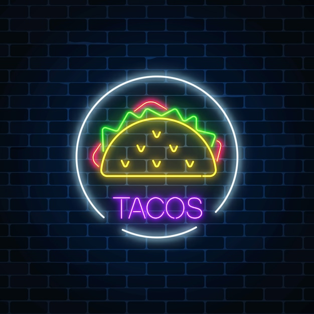 Neon glowing sign of tacos in circle frame on a dark brick wall Premium Vector