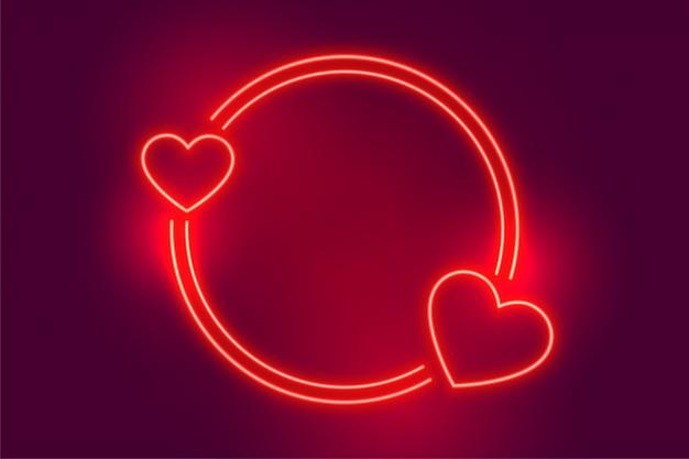 Неоновый красный два сердца кадр с пространством для текста Бесплатные векторы