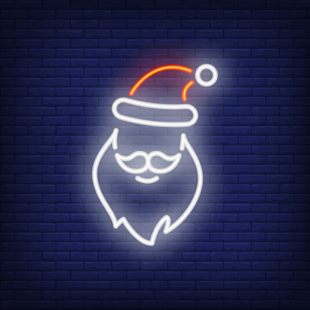 Neon santa claus shape. festive element. christmas concept for night bright advertisement Free Vector