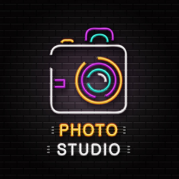 Neon sign of camera for decoration on the wall background. realistic neon logo for photo studio. concept of photographer profession and creative process. Premium Vector