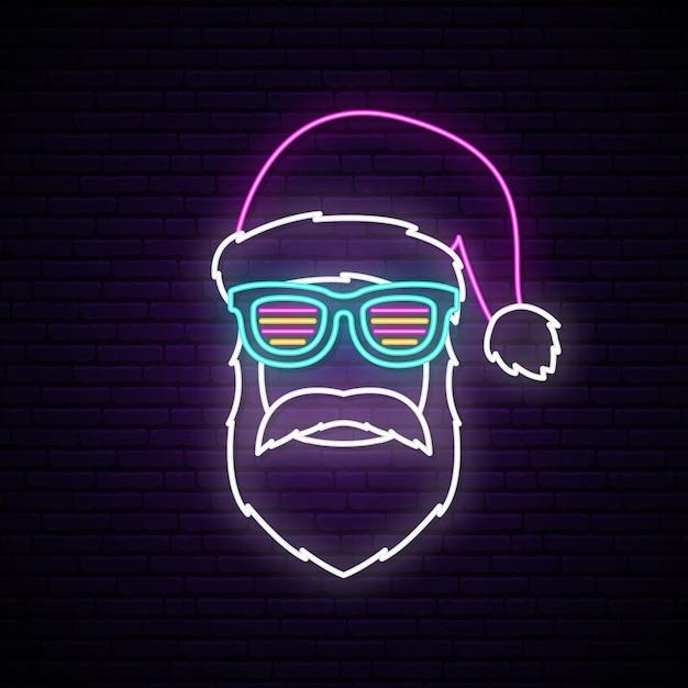 Neon signboard with santa claus portrait. Premium Vector