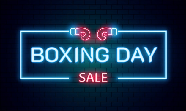 Neon text boxing day sale on brick wall background. Premium Vector