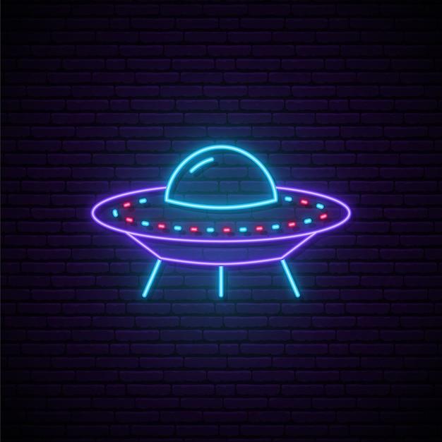 Neon ufo sign. Premium Vector