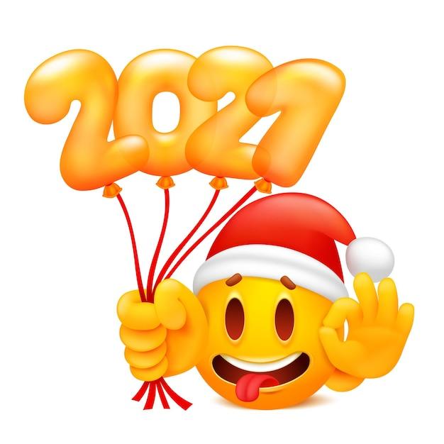 New year 2021 sticker with yellow cartoon emoji character in santa claus hat. Premium Vector