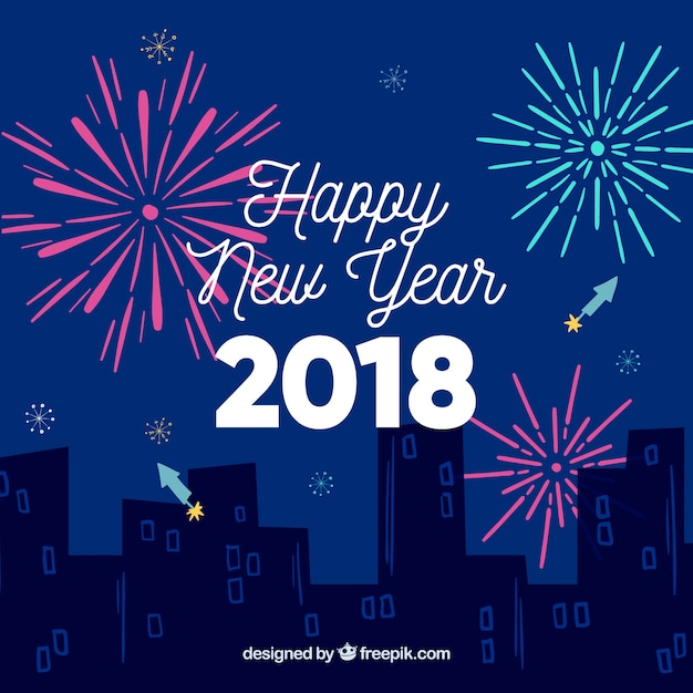 new year background with a night city and fireworks free vector