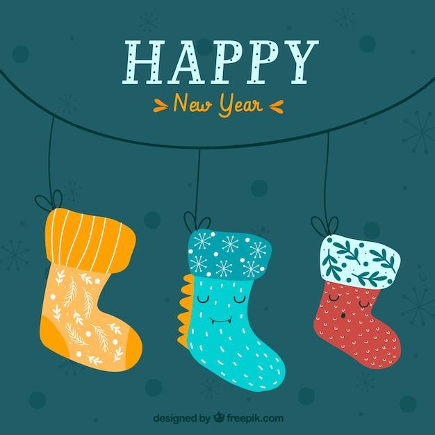 かわいい手で靴下を描いた新年の背景 無料ベクター