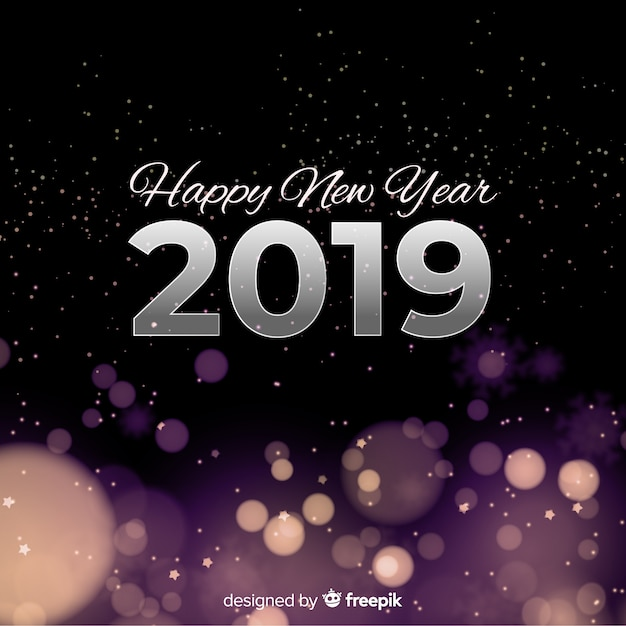 New year blurred lights background Free Vector