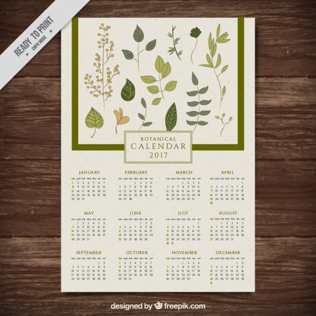 New year calendar with hand drawn leaves Free Vector