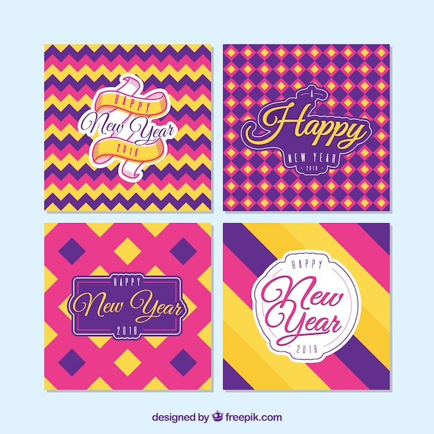 new year cards with geometric patterns in pink purple and yellow free vector