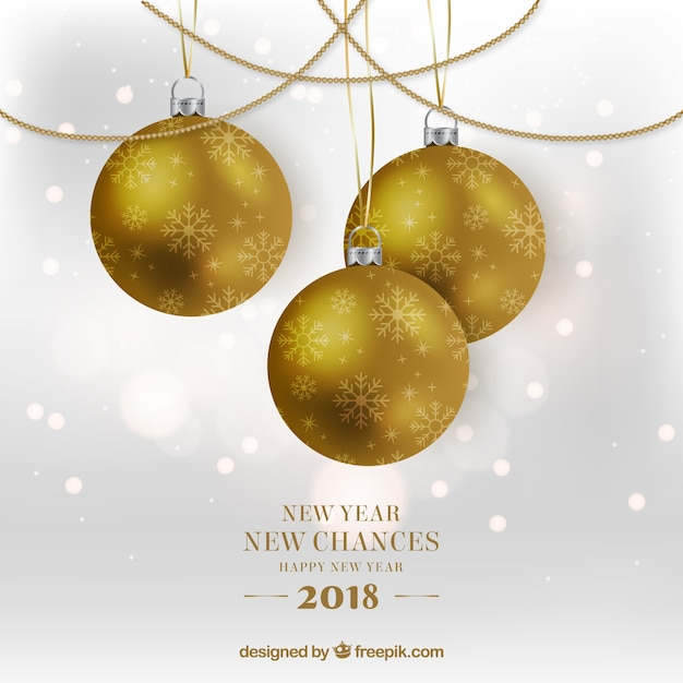 New year new chances background with golden\ baubles