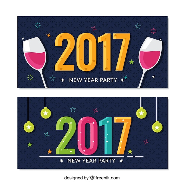 New year\'s party banners with baubles and\ toast