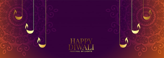 Nice diwali banner with beautiful decoration Free Vector