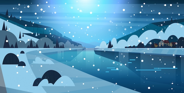 Night winter nature landscape houses on frozen river hills and falling snow Premium Vector