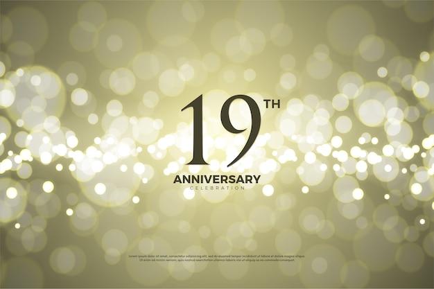 Девятнадцатая годовщина с золотым бумажным фоном Premium векторы