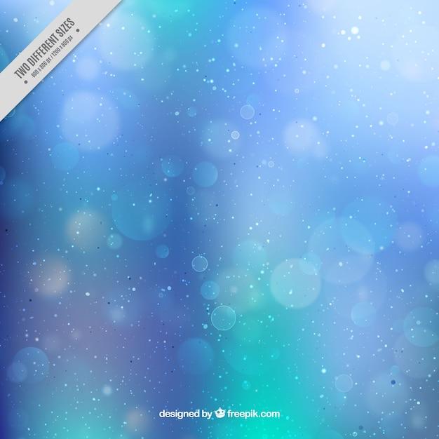 Синий сфокусировано фон Боке Бесплатные векторы