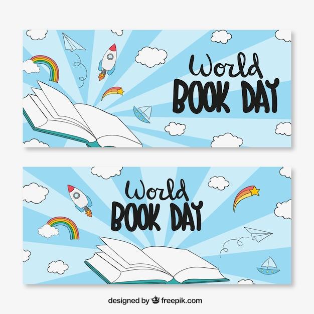 世界の本の日の雲とロケットと手描きのバナー 無料ベクター