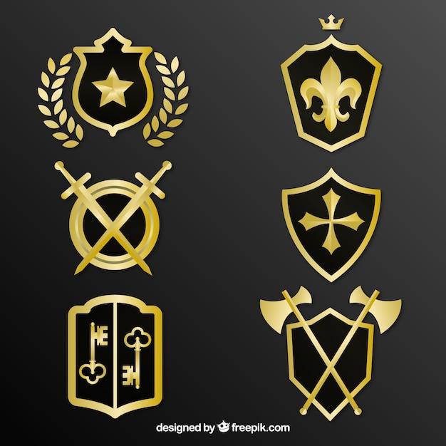 装飾的な黄金の盾のパック 無料ベクター