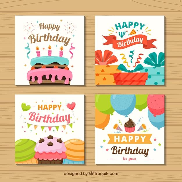 フラットデザインの4つのカラフルな誕生日カードのセット 無料ベクター