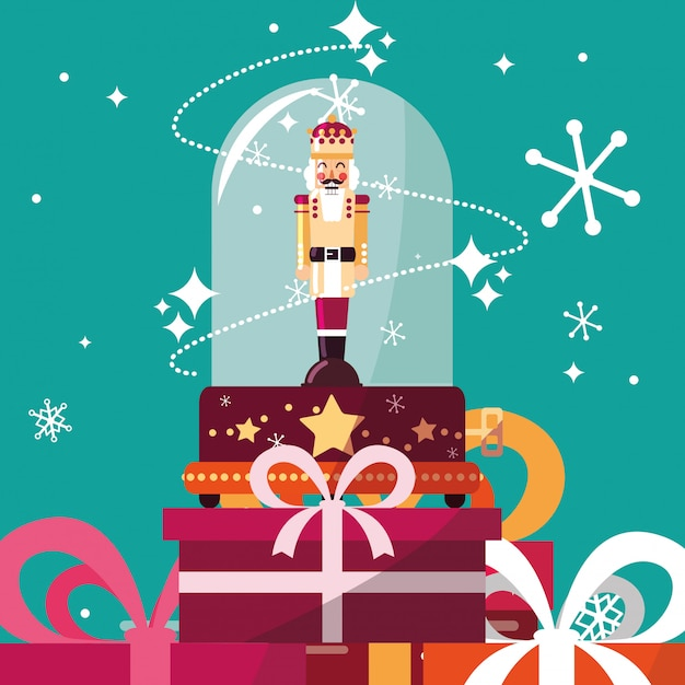 Nutcracker king in crystal sphere with gift boxes presents Premium Vector