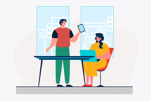 Office colleagues using digital devices Free Vector