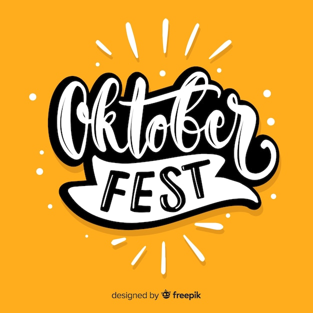 Oktoberfest lettering with yellow background Free Vector