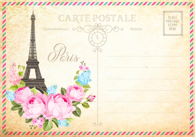 Old blank postcard with post stamps and eiffel tower with spring flowers on the top. Premium Vector