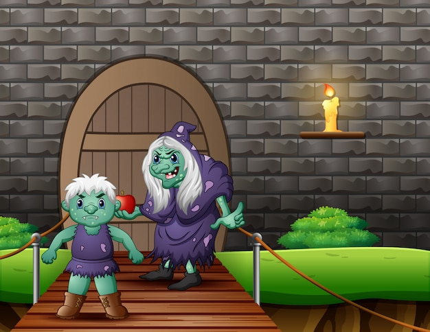 Old evil witch with a giant in front the house Premium Vector