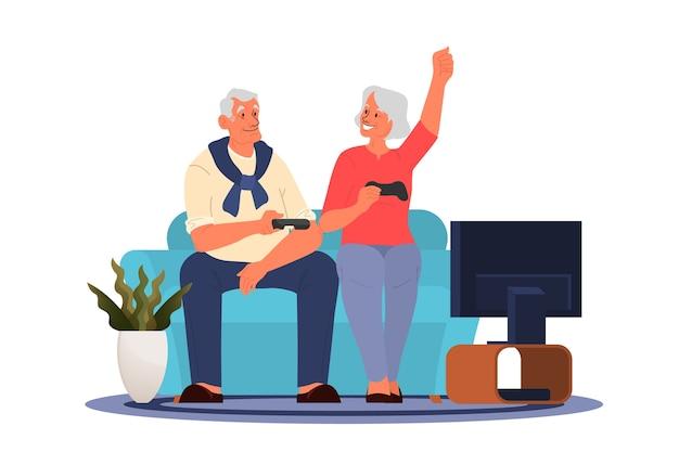 ビデオゲームをプレイする老人。コンソールコントローラーでビデオゲームをプレイする高齢者。高齢者のキャラクターは現代的なライフスタイルを持っています。 Premiumベクター
