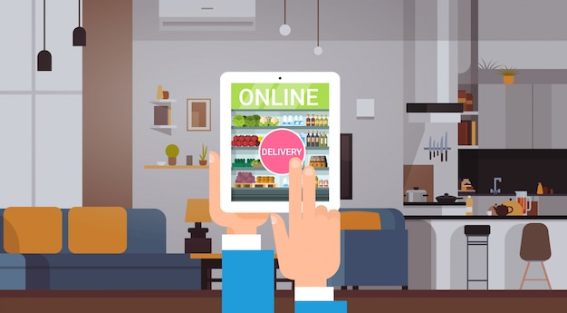Online grocery products delivery service concept people ordering food with digital tablet application from home Premium Vector