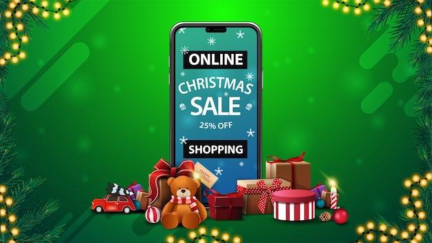 Интернет-магазины, рождественская распродажа, скидка до 25%, скидочный баннер со смартфоном с предложением на экране и подарками вокруг Premium векторы