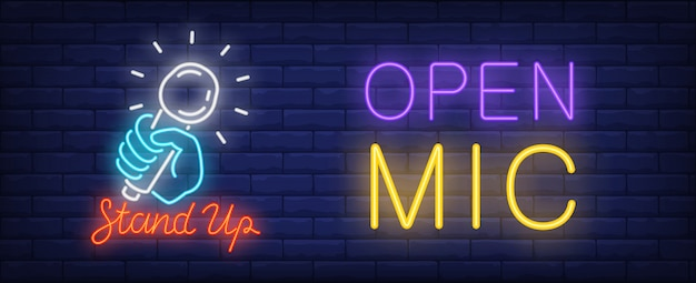 Open mic for stand up neon sign. bright blue hand holding shining microphone Free Vector
