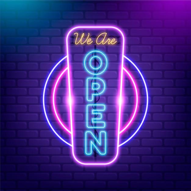 Open shop sign in neon lights Free Vector