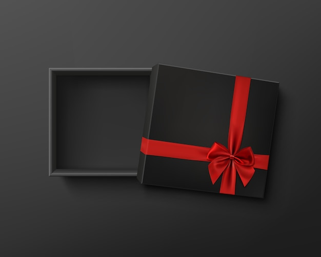 Opened black empty gift box with red ribbon and bow on dark background. Premium Vector