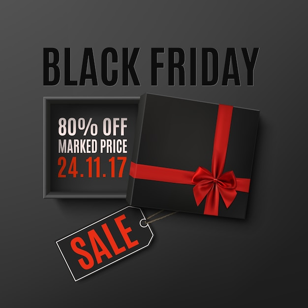 Opened black empty gift box with red ribbon, bow and price tag on dark background. top view. Premium Vector