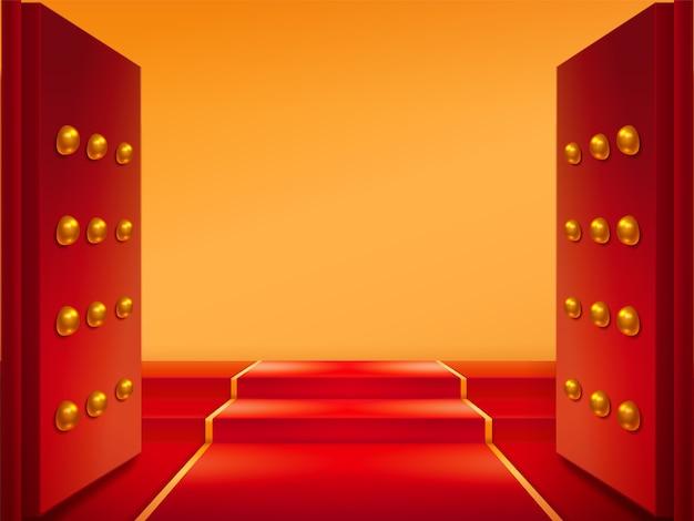 Открытые ворота с золотом и красной ковровой дорожкой на лестнице. двери и тапи у восточного входа в замок Premium векторы