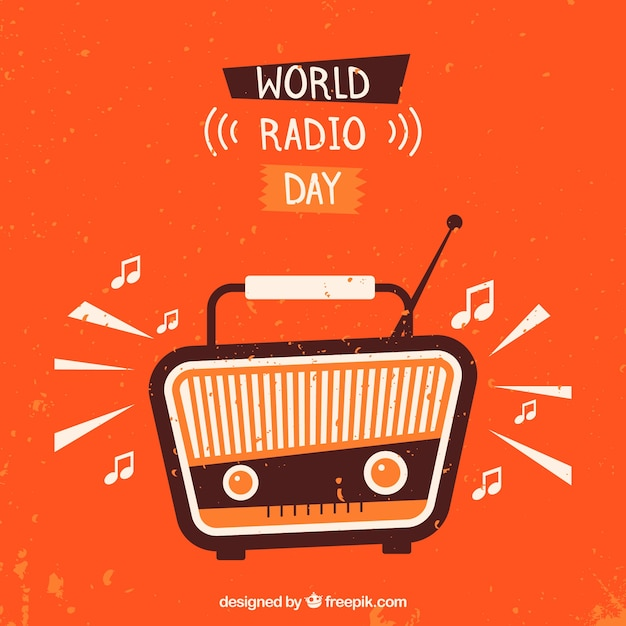 Orange background with vintage radio to celebrate world radio day Free Vector