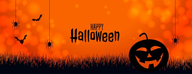 Orange halloween banner with pumpkin spider and bats Free Vector