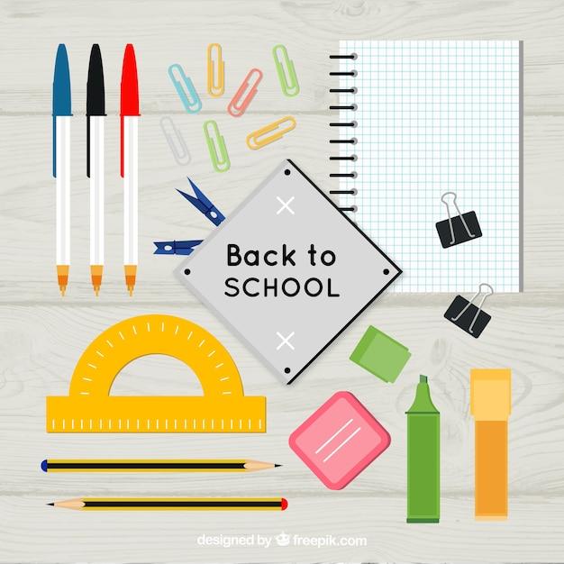 Organized school materials on the desk Free Vector