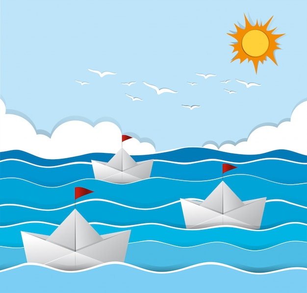 Origami boats sailing in the sea Free Vector