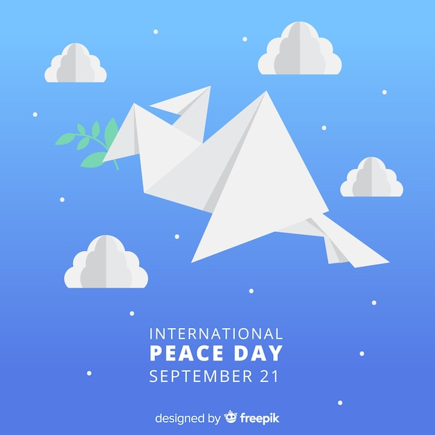 Origami dove holding branch surrounded  by clouds and stars Free Vector