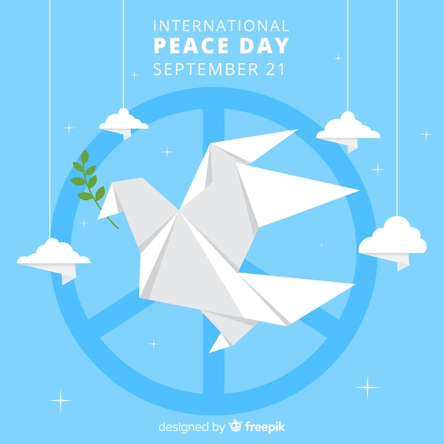 Origami dove with peace symbol and clouds around it Free Vector