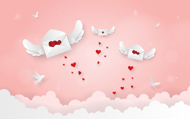 Origami letter with wings flying on the sky Premium Vector