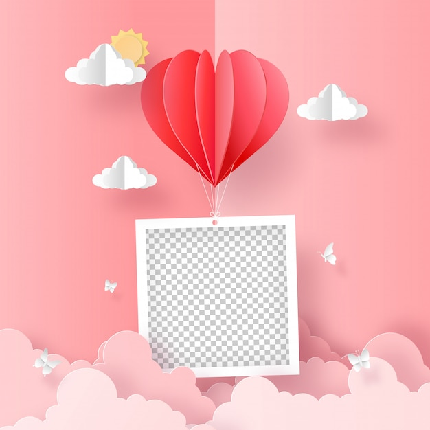 Origami paper art of blank photo with heart shape balloon on the sky Premium Vector